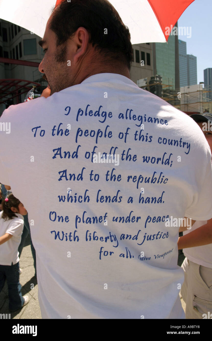 Man wearing t-shirt with pledge of allegiance written on back. Immigration rally, Dallas, Texas, USA - Stock Image
