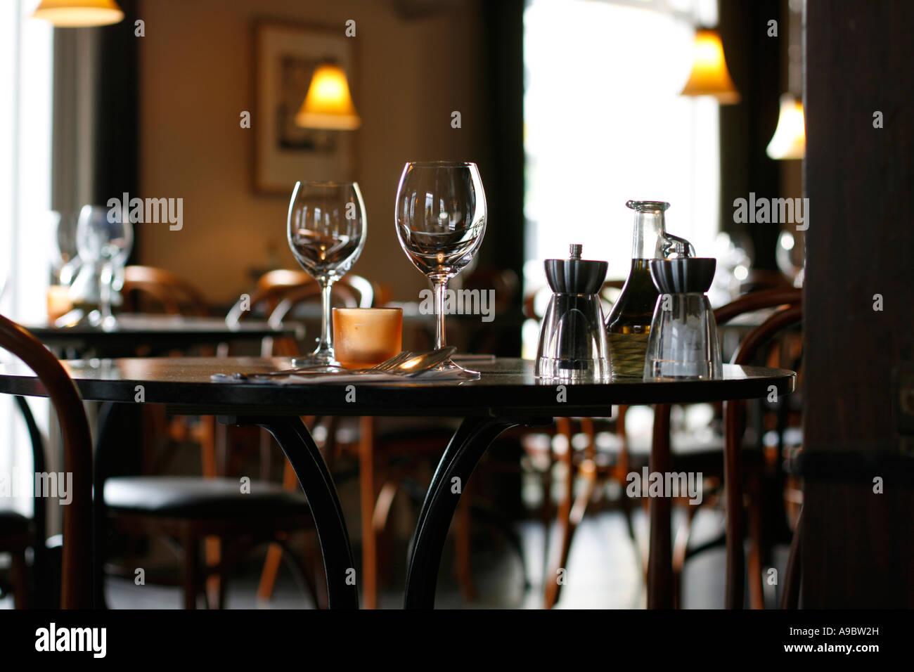 Interior Of A Cozy Restaurant Focusing On A Ready Table For Two - Table for two restaurant