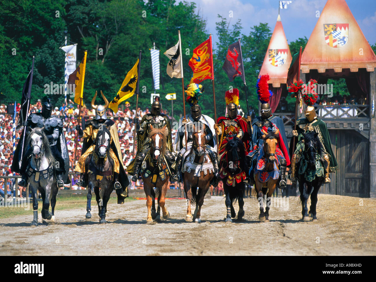 Knights on horse holding lance flag in tournament Medieval festival in Kaltenberg Bavaria Germany Stock Photo