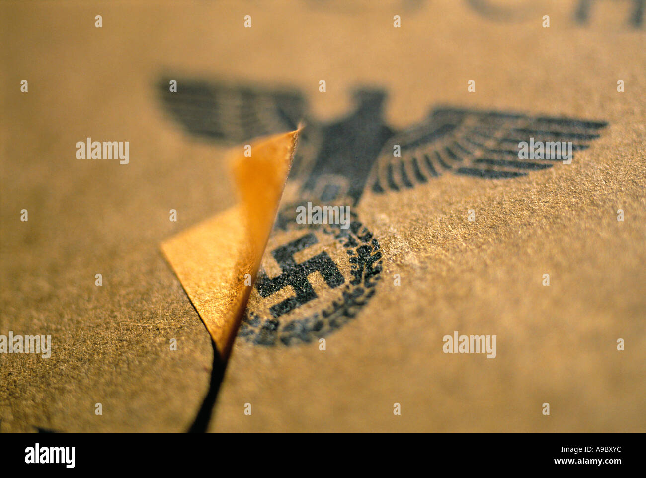 The third empire from nazi german the logo of the a german passport covered with a piece of paper after the second world war - Stock Image