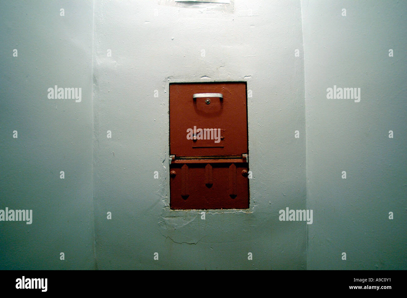Woman holds open door to compactor chute & Woman holds open door to compactor chute Stock Photo: 7039152 - Alamy