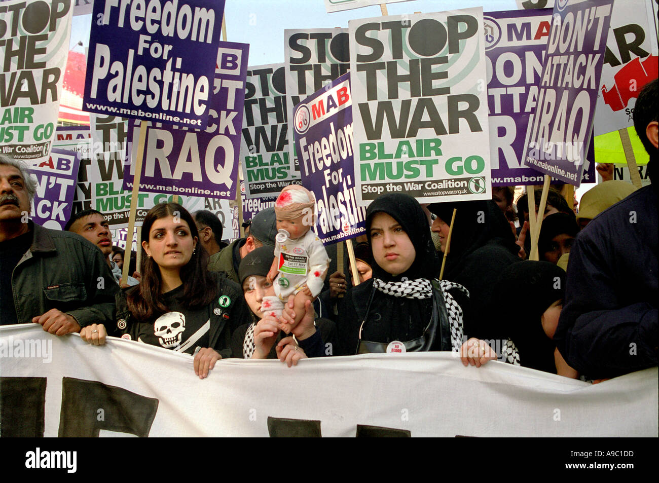 Muslim protestors marching through central London protesting the war in Iraq in February 2003. - Stock Image