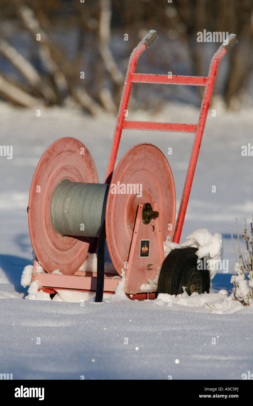 Empty red hose reel on snow & Empty red hose reel on snow Stock Photo: 12320153 - Alamy