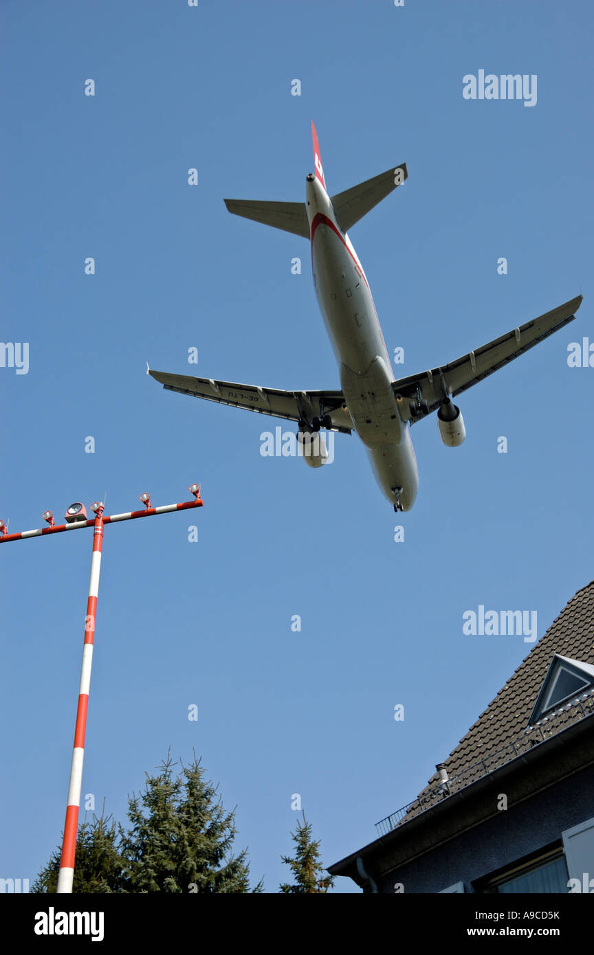 Jet approaching Duesseldorf International Airport, Germany. - Stock Image