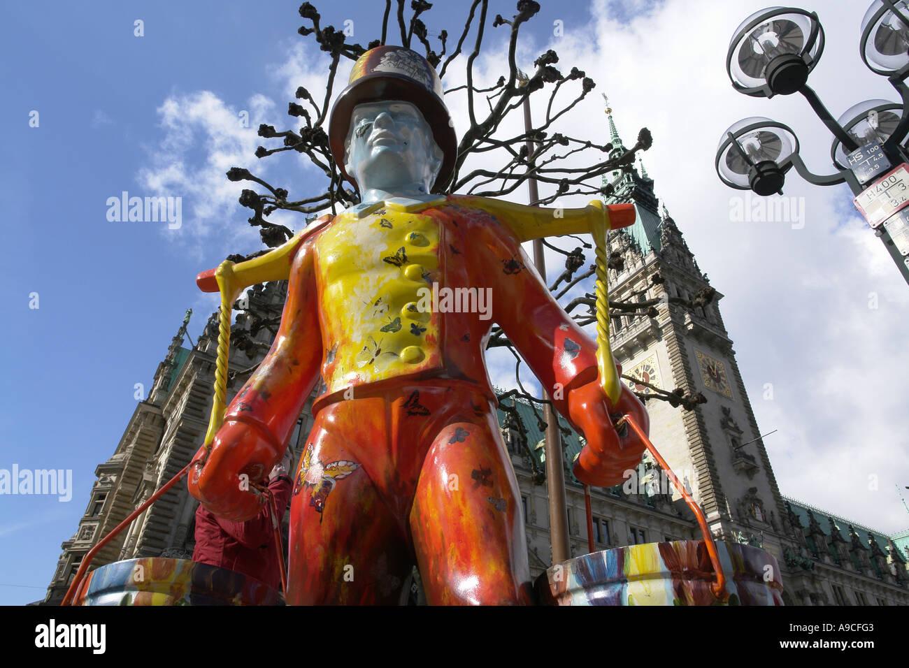 Hans Hummel Hamburger wasserträger at Rathausplatz townhall square Hamburg Hansestadt Germany - Stock Image