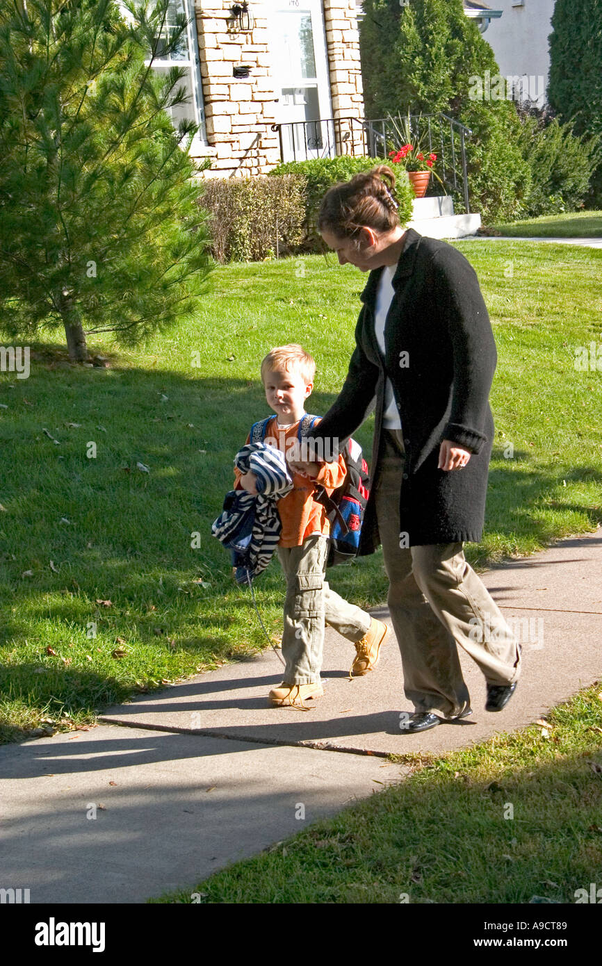 Mom asking son how his day at school went. St Paul Minnesota MN USA - Stock Image