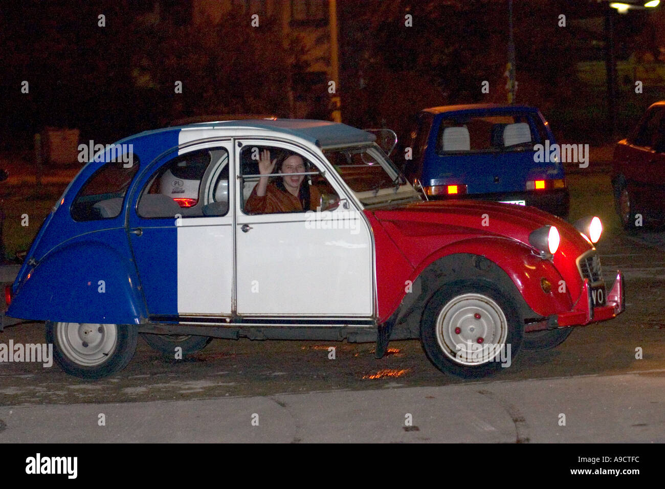 citroen 2cv or french deux chevaux auto red white and blue with woman stock photo 4024571 alamy. Black Bedroom Furniture Sets. Home Design Ideas
