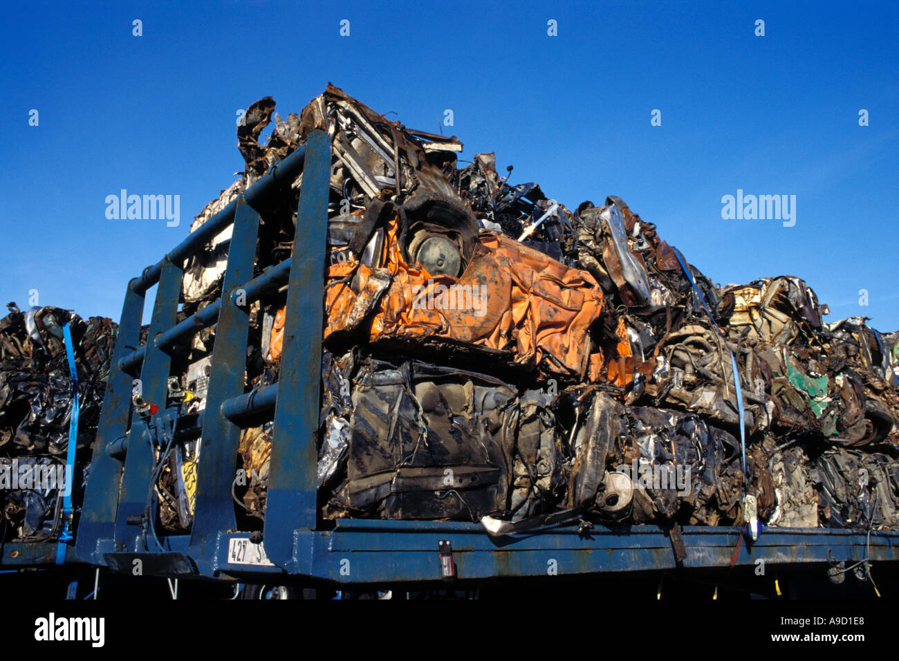 Breaker s yard - compressed vehicles ready for reprocessing - Stock Image