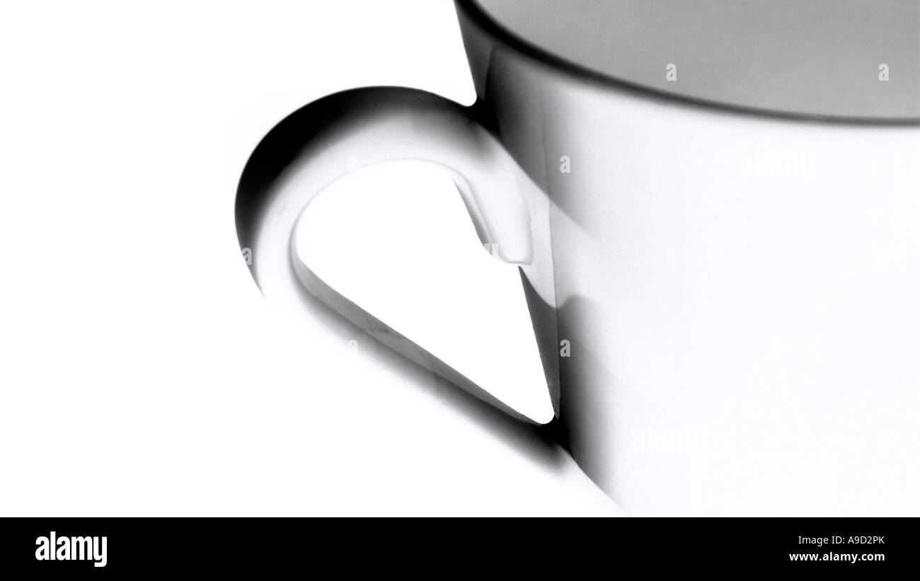 Detail of a cup rim and handle against a white background - Stock Image
