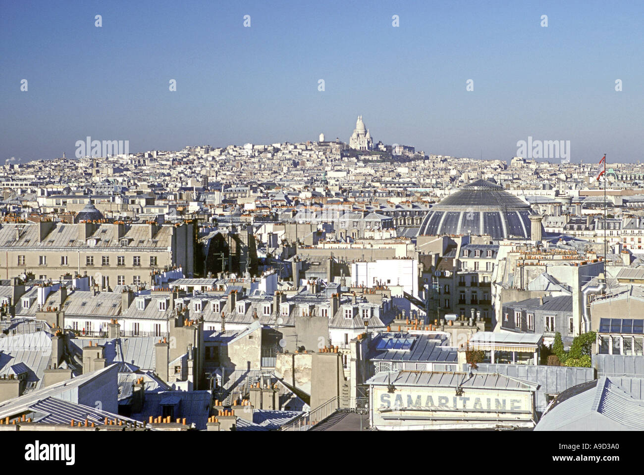 Paris skyline with the Sacre Coeur cathedral visible on the horizon. - Stock Image