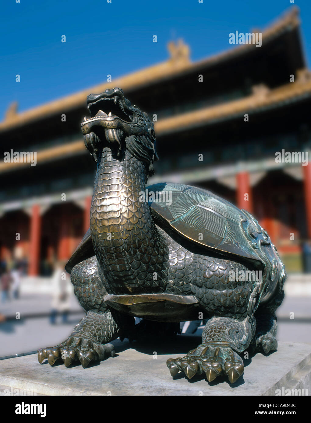 Bronze statue of a turtle with a dragon's head in front of the Tai He Dian Hall, Imperial Palace, Forbidden City, Beijing, China - Stock Image