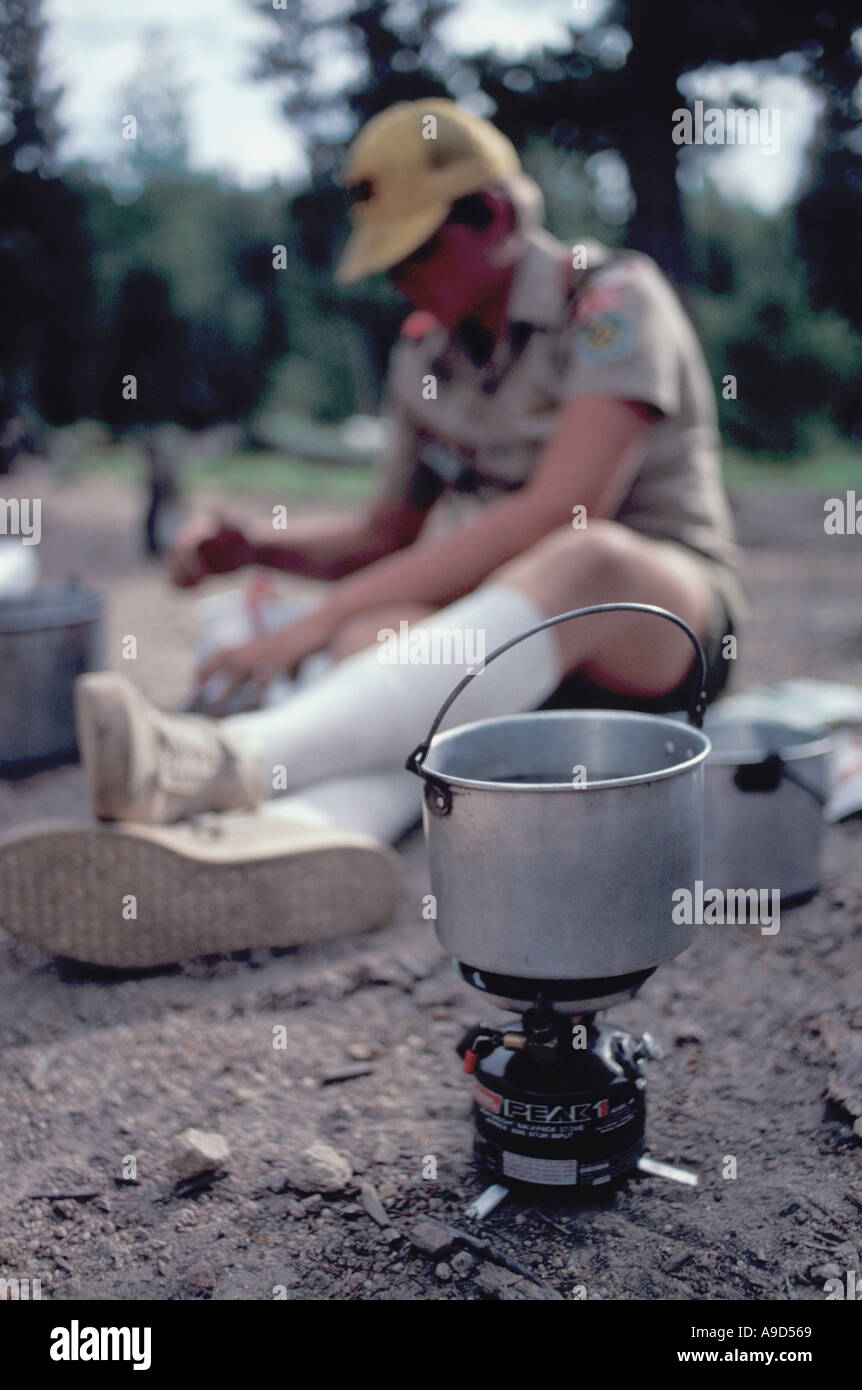 Boy Scout and Coleman camp stove - Stock Image