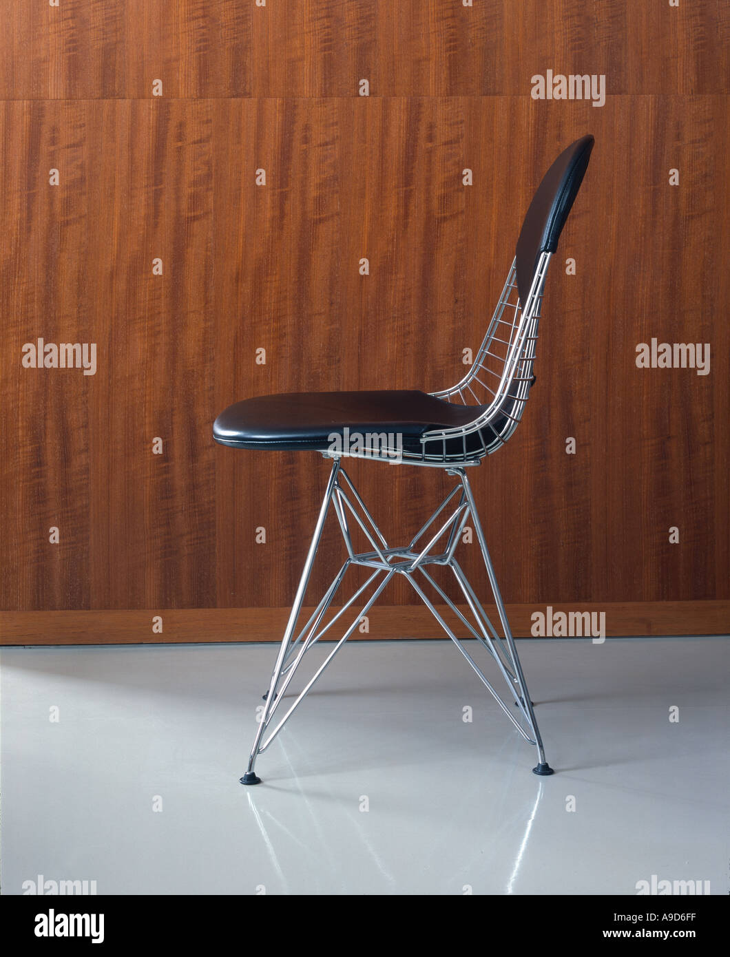 Small apartment with African collection. DKR Wire Base Chair with bikini pad by Charles and Ray Eames (1951). Stock Photo
