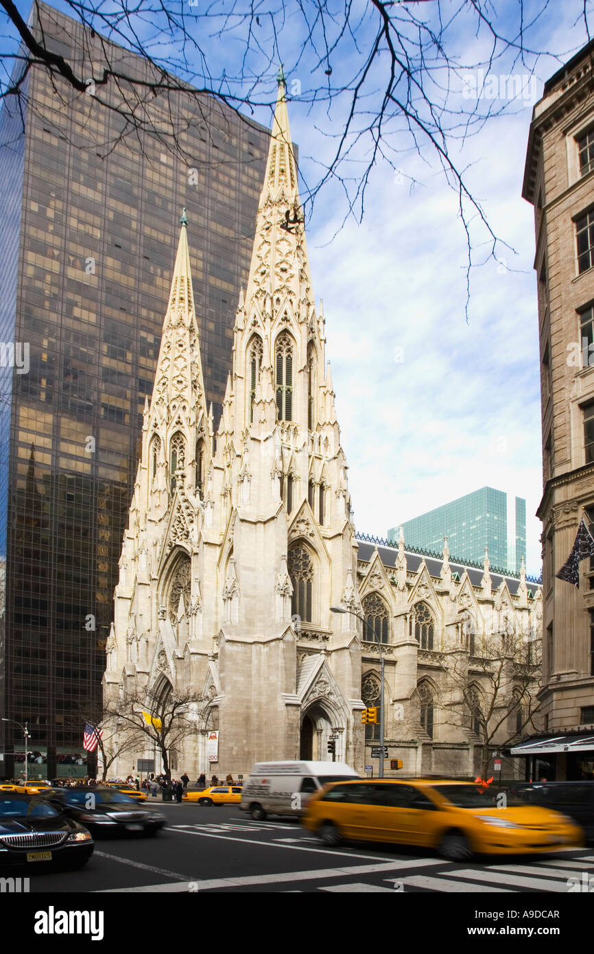 St Patricks Patrick's Cathedral and yellow taxi cab on 5th Fifth Avenue midtown Manhattan New York City NY United - Stock Image