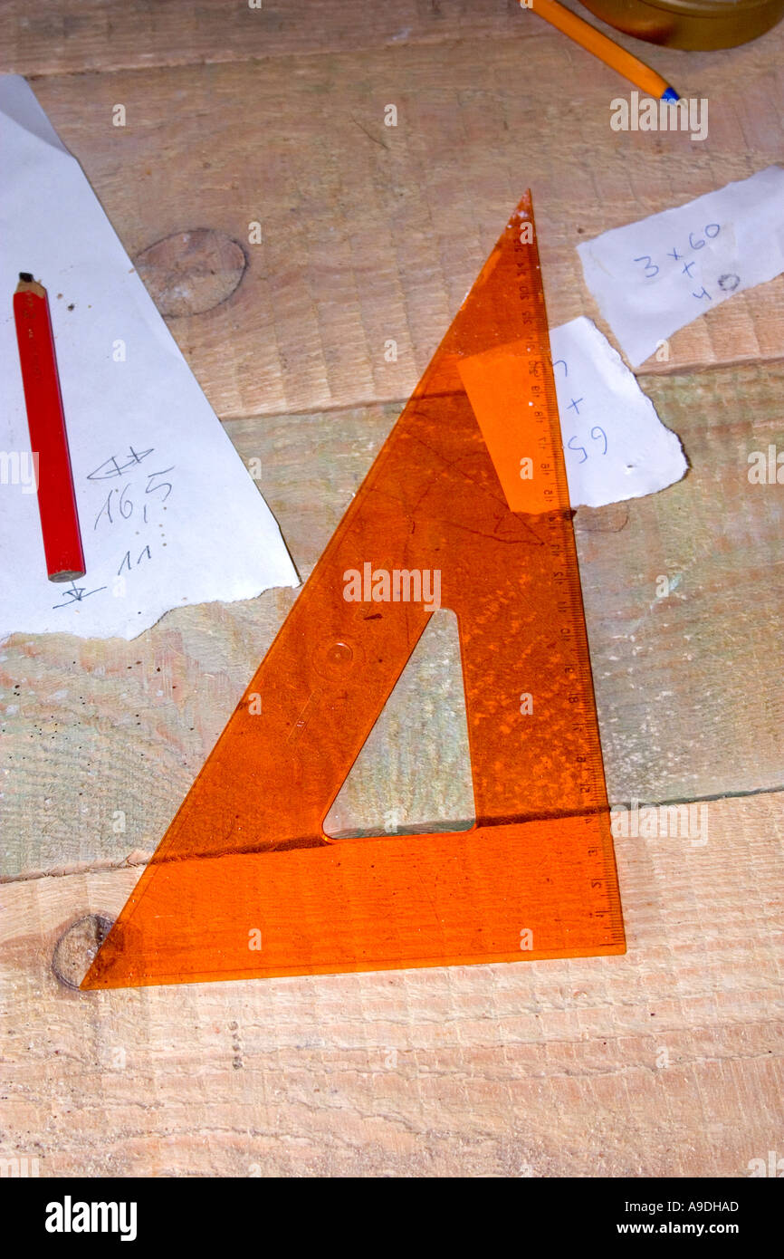 Draftsmen's metric triangle ruler and measuring plans. Zawady Poland - Stock Image
