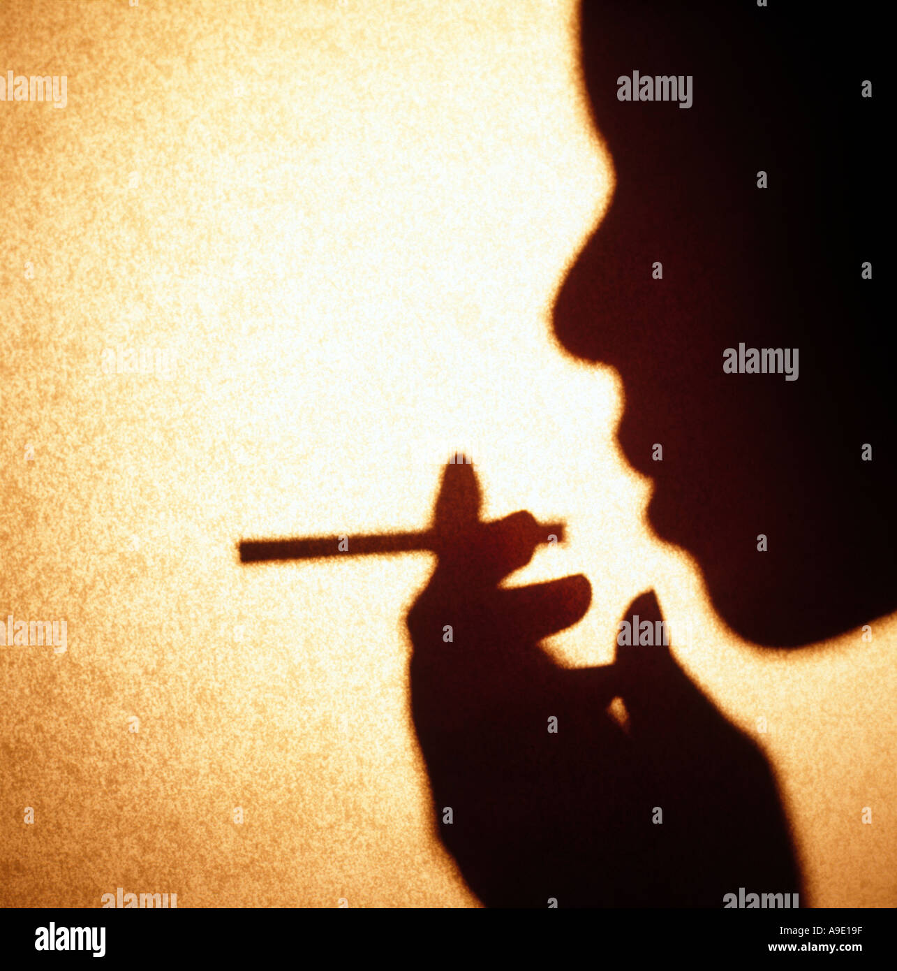 Woman African American smoking holding cigarette - Stock Image