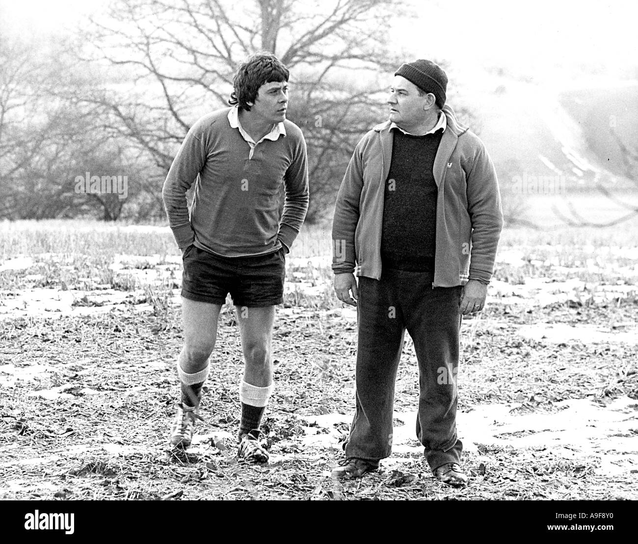 PORRIDGE 1978 Black Lion film with Ronnie Barker at right as Fletcher and Richard Beckinsale as Godber - Stock Image