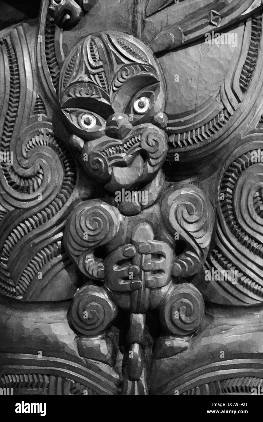 A traditional Maori carving decorating the wall of the Canoe House at Waitangi National Reserve in the North Island, - Stock Image