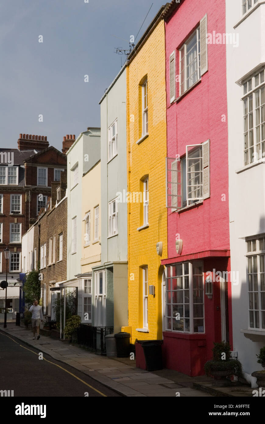 Colourfully painted houses .The Royal Borough of Kensington and  Chelsea. London SW3. England.  HOMER SYKES Stock Photo