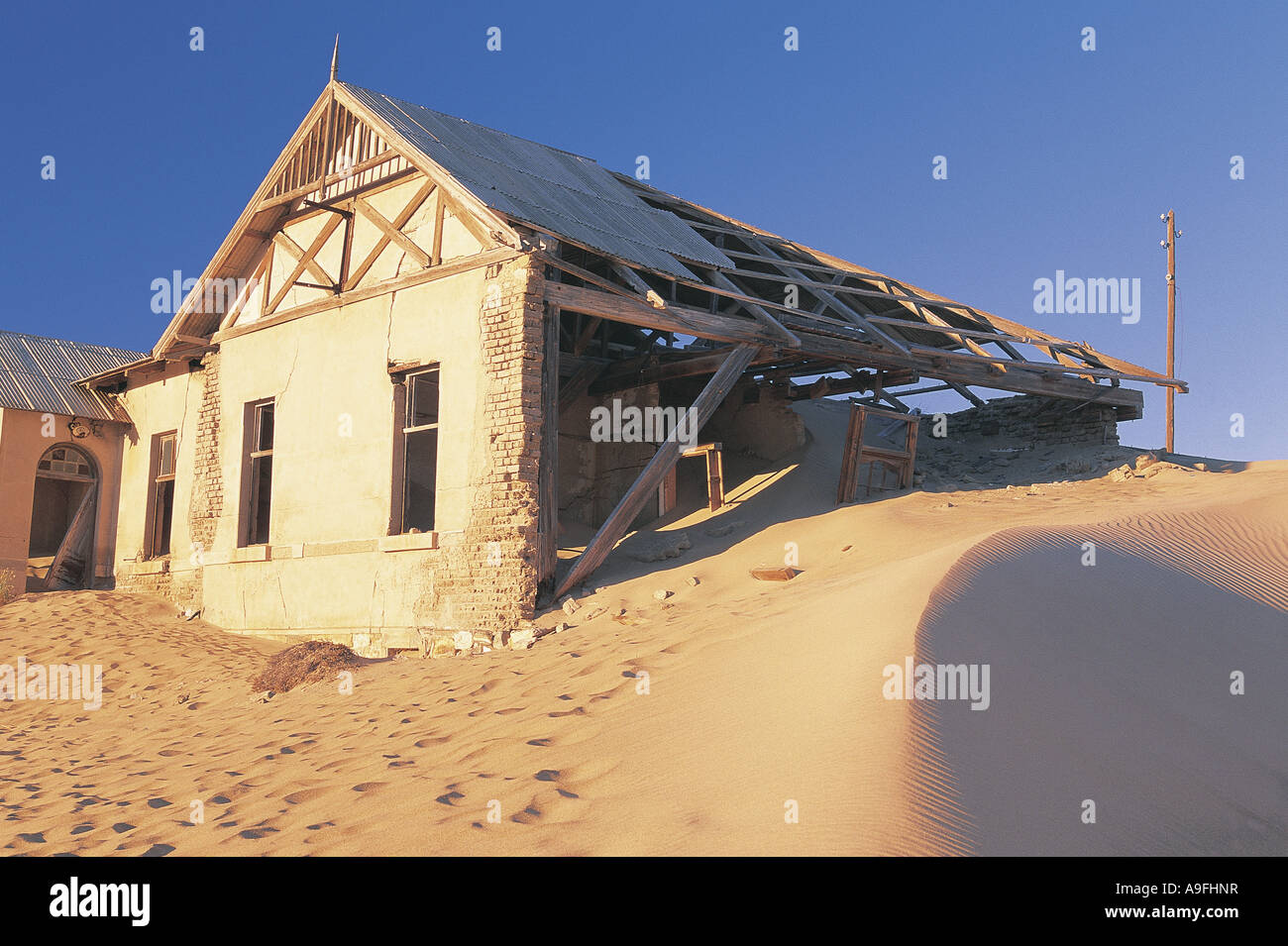 Abandoned and wrecked house in the ghost mining town of Kolmanskop Namibia south west Africa - Stock Image