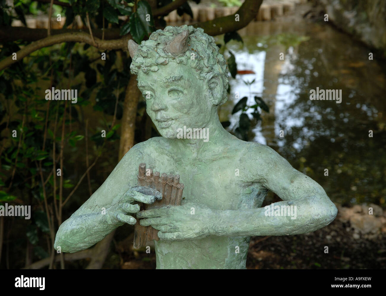Statue of Pan in the grounds of Pashley Manor in East Sussex. - Stock Image