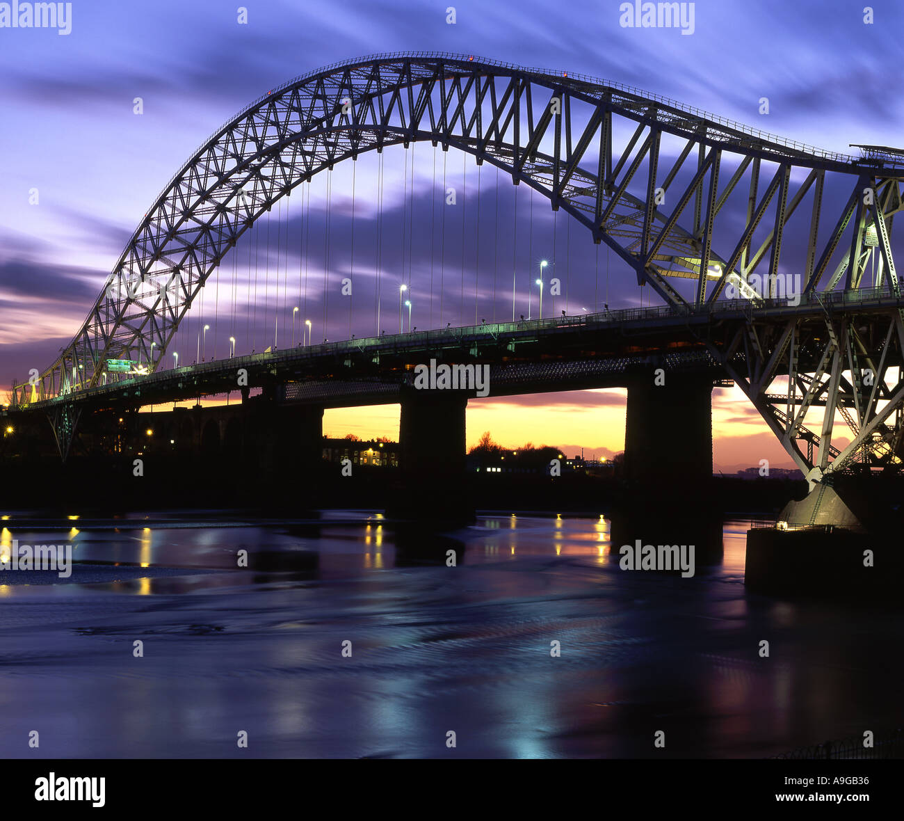 The Runcorn and Widnes Roadbridge Over the River Mersey at Night, Cheshire, England, UK - Stock Image