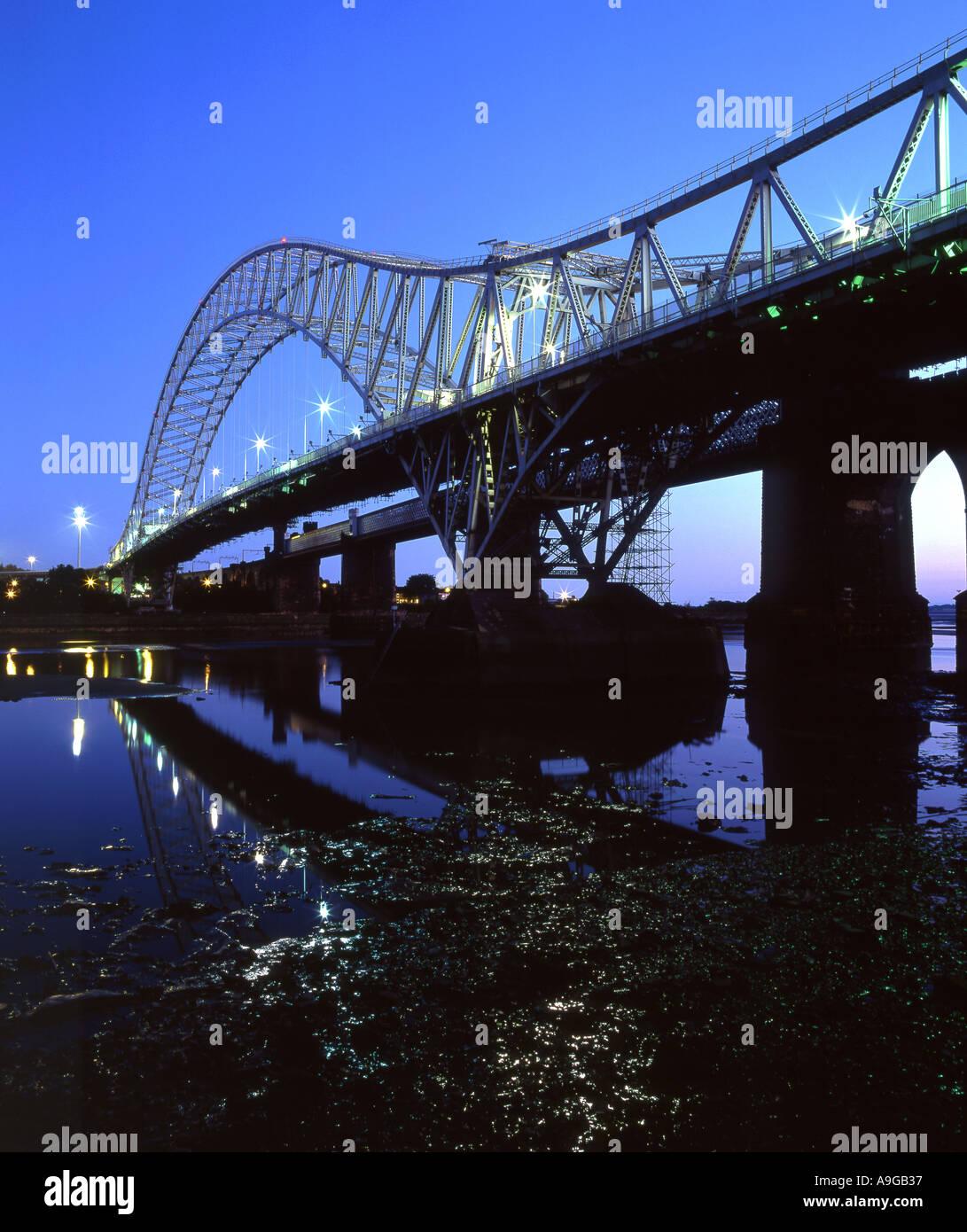 The Runcorn Widnes Roadbridge Spanning the River Mersey at Night Cheshire UK - Stock Image