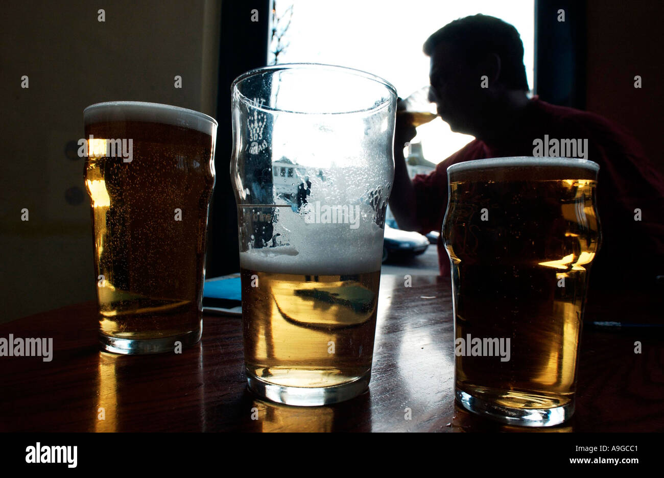 A quiet pint in a traditional English pub on a sunny afternoon - Stock Image