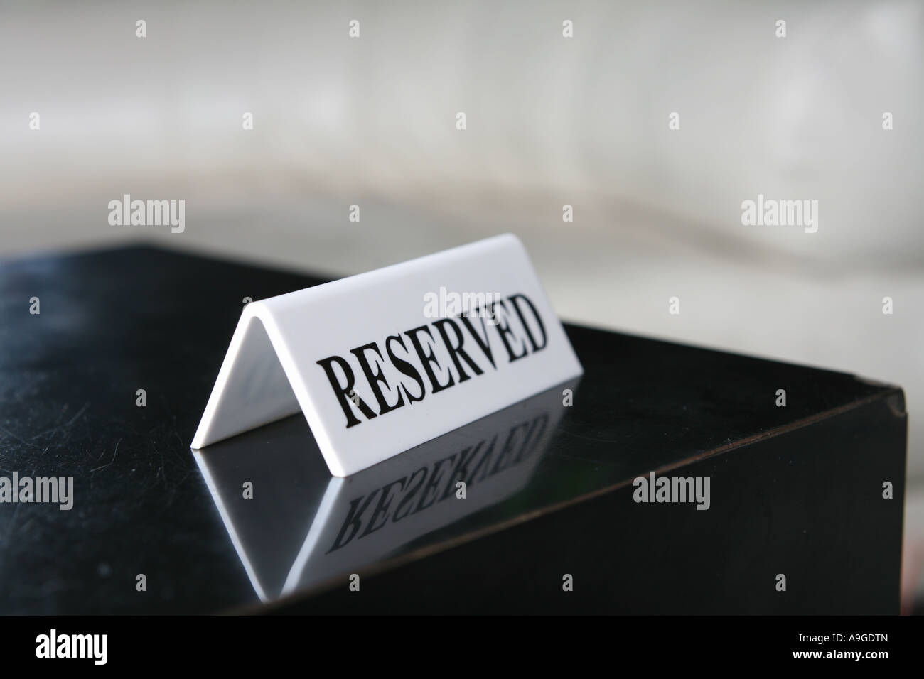 reserved sign on a bar table - Stock Image