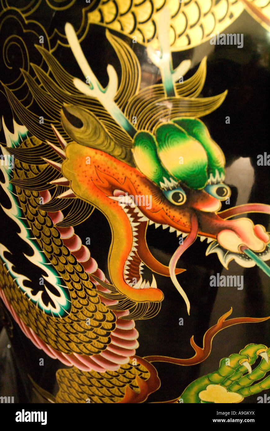 Dragon design on porcelain vase in workshop in Pingyao, Shanxi, China - Stock Image