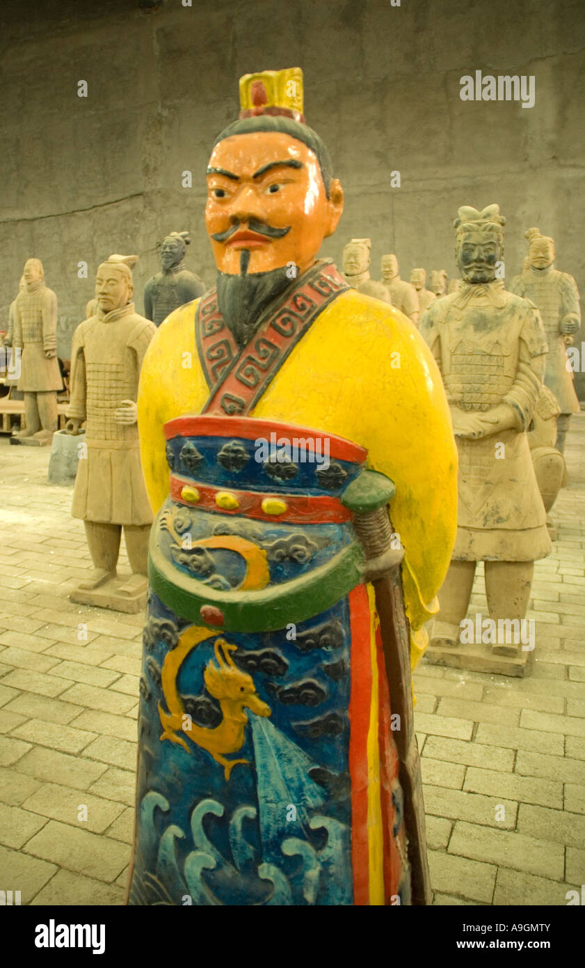 Colorfully painted replica of a terra cotta warrior from the army of Emperor Qin in workshop, Xi'an, Chian - Stock Image