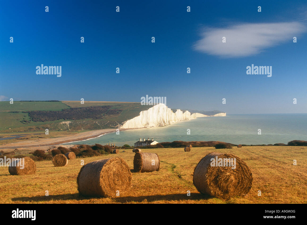 white cliffs and straw bales with the white cliffs of the Seven Sisters Sussex England UK - Stock Image