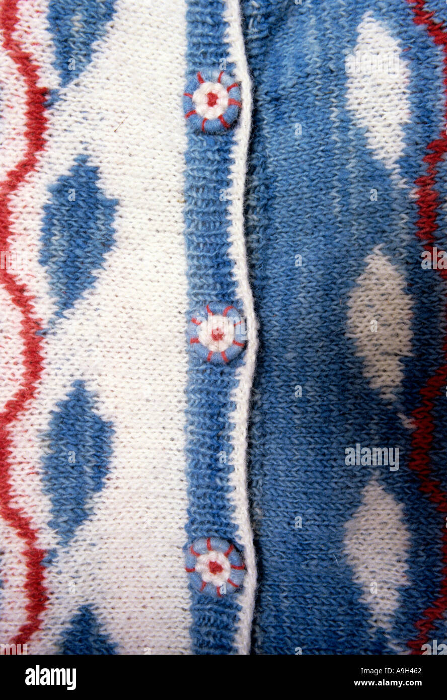 Three Dorset buttons fasteners on a hand knitted caridigan. - Stock Image