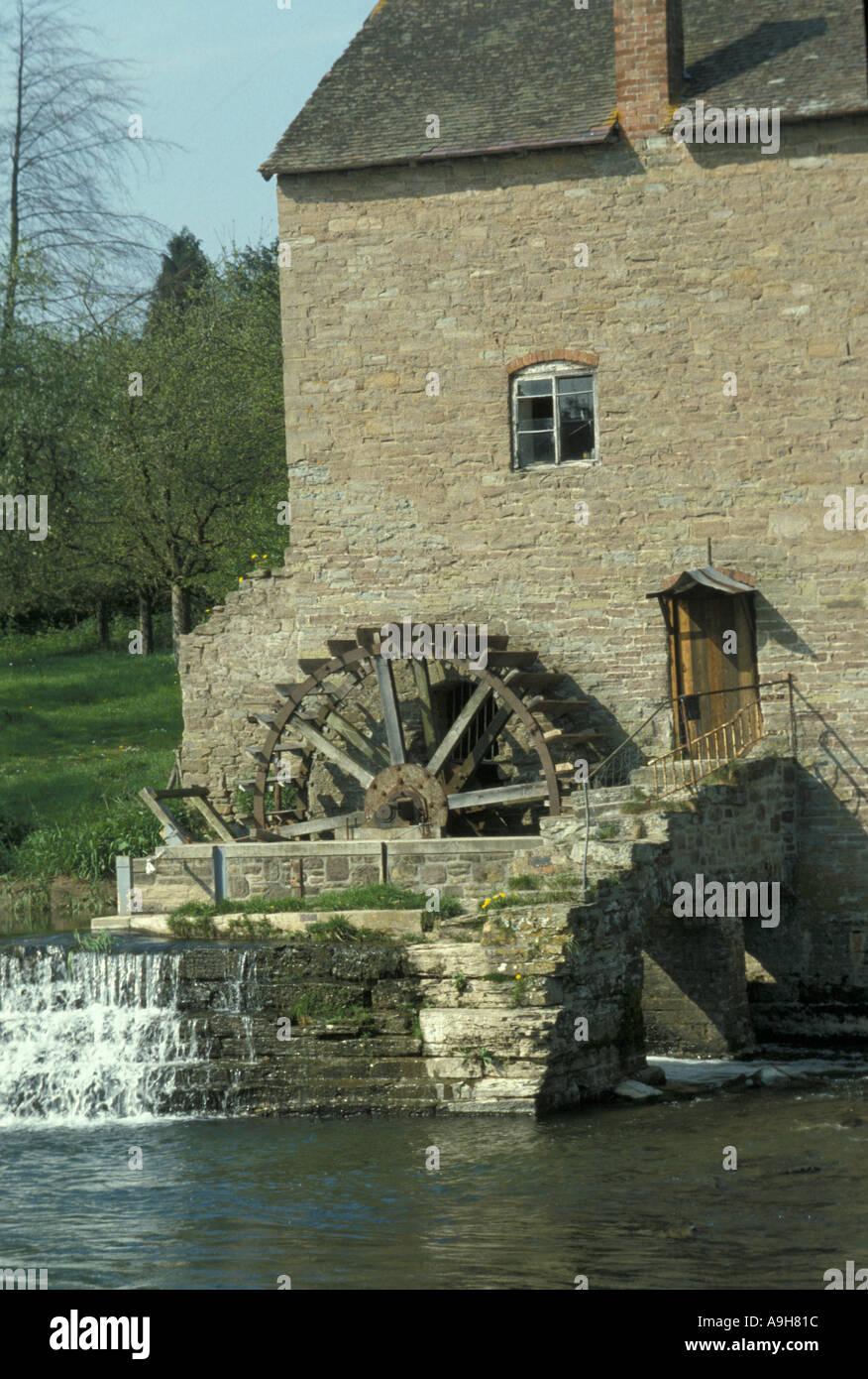 Power Water Derelict water wheel besides a Shropshire stream - Stock Image