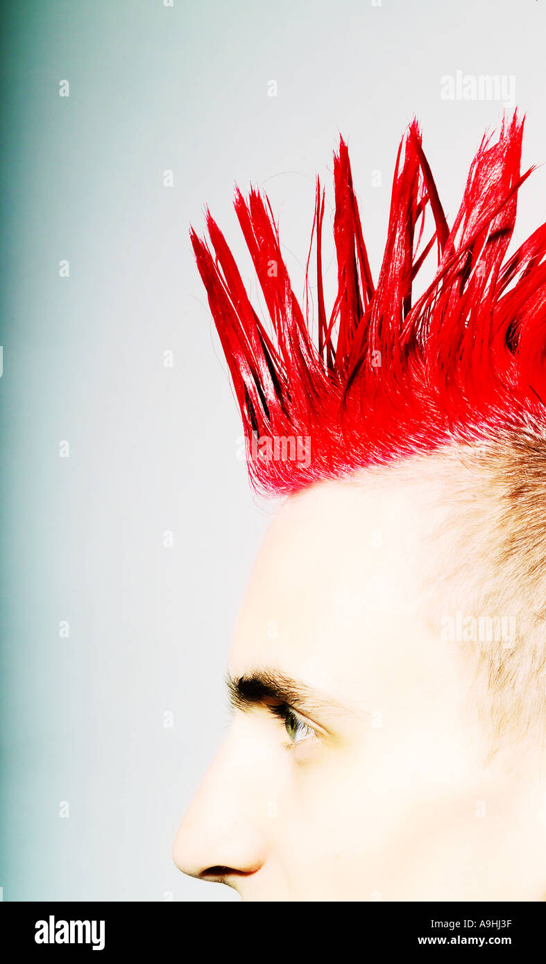 Side view of Punk rocker with red mohican Stock Photo