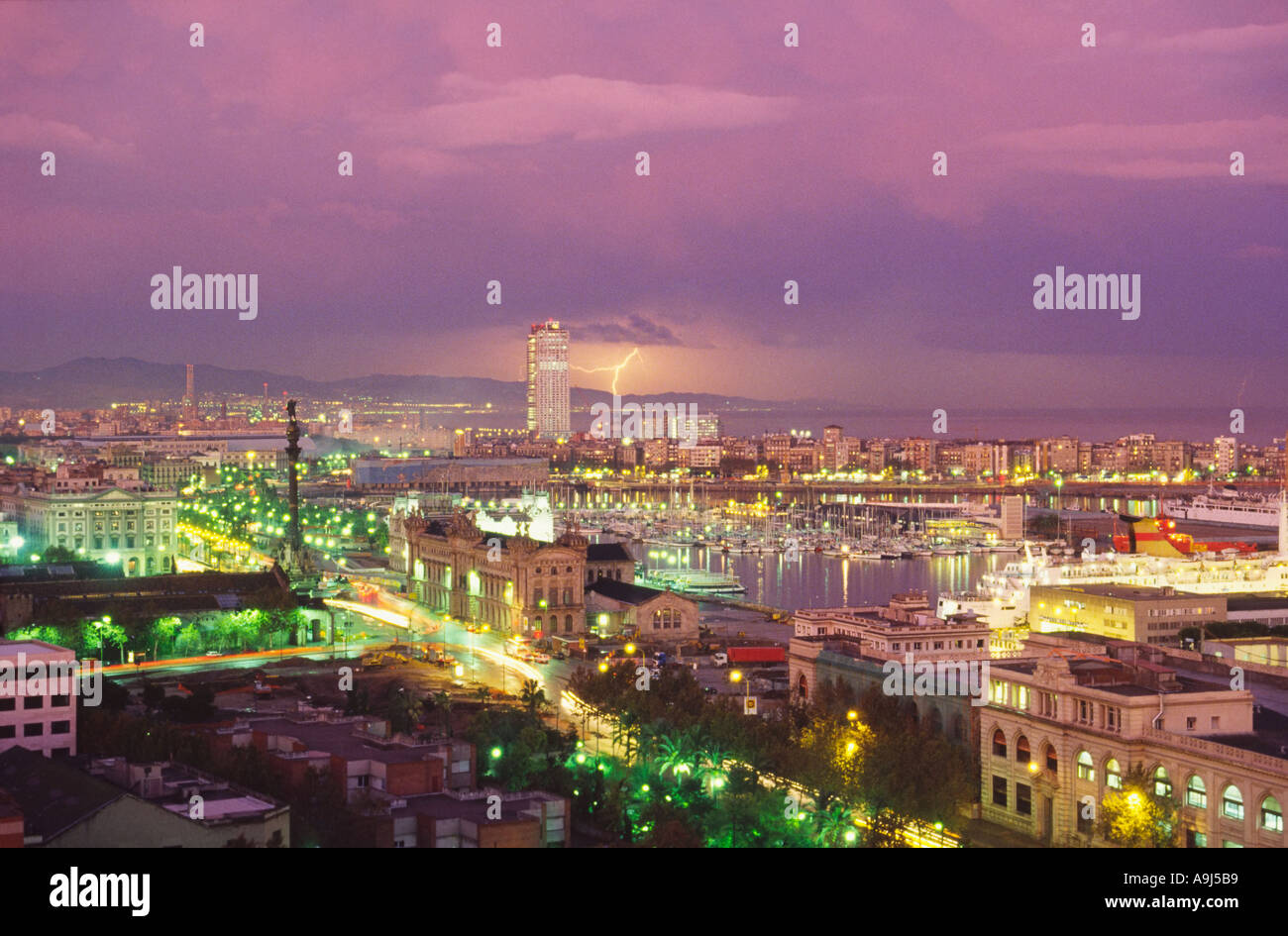 ESP Spanien Barcelona panoramic view from Montjuic hill colomus statue harbour thunderstorm Stock Photo