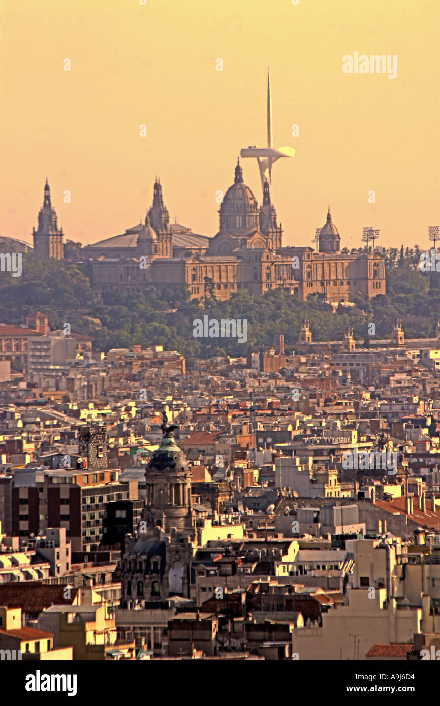 ESP Spanien Barcelona Palau National Olympic Tower Montjuic by architect Norman Forster Teleshot from Sagrada Familia Stock Photo