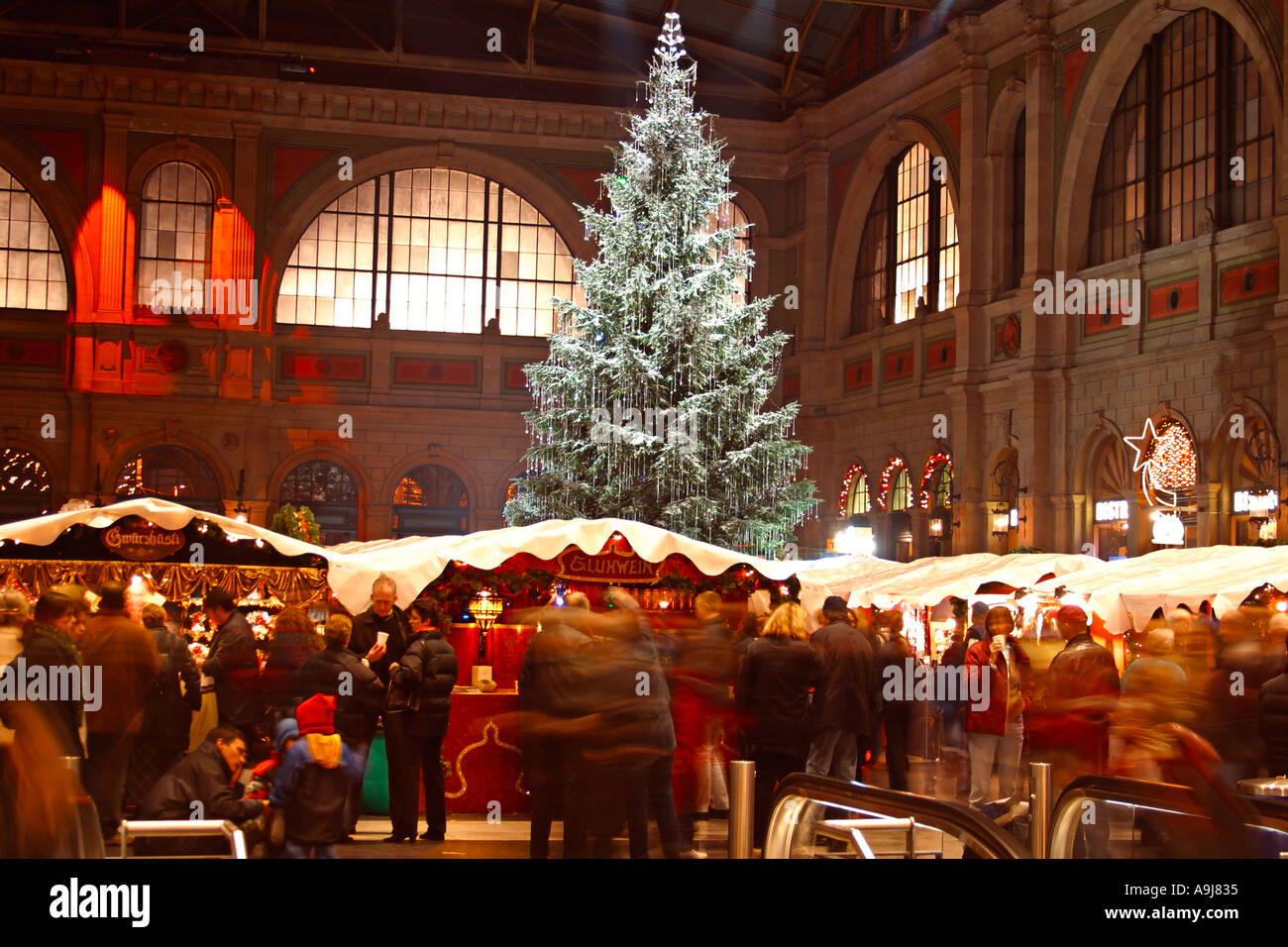 Switzerland Zurich main station indoor chirstmas market stalls - Stock Image