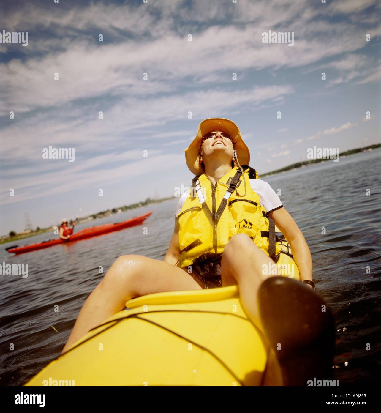 twenties something woman out kayaking - Stock Image
