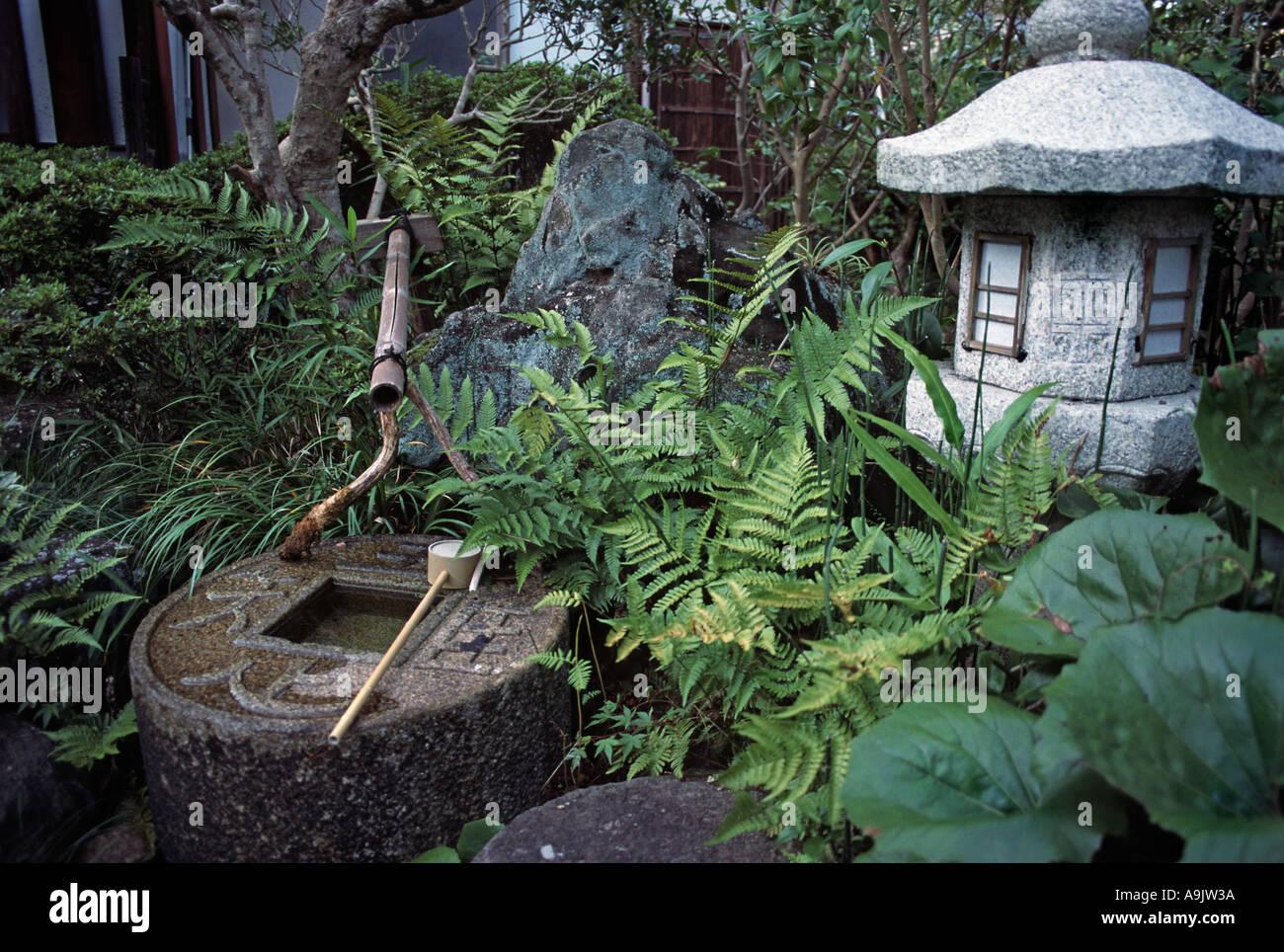 Lush grounds of a local ryokan Nara prefecture Japan - Stock Image