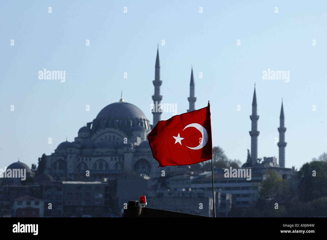 Turkish flag and Suleymaniye mosque in background Istanbul - Stock Image