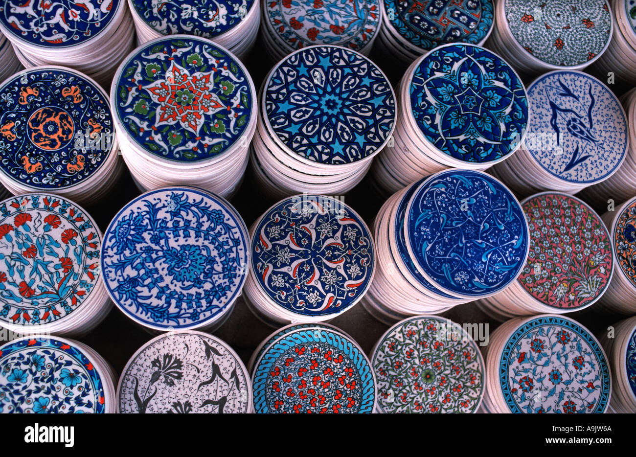 Detail of stacks of circular ceramic tiles for sale at souvenir ...