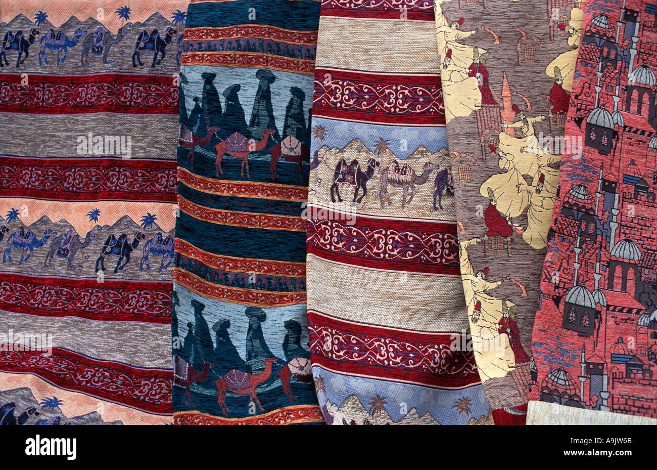 Display of woven fabrics with distinctive motifs for sale at souvenir markets in the Zelve and Goreme valleys Cappadocia Stock Photo