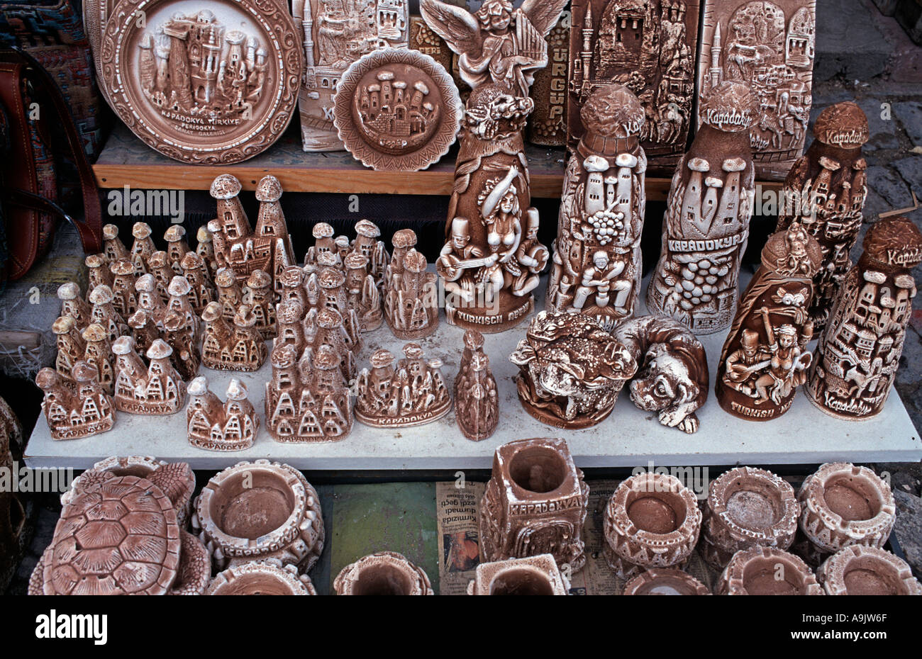 Selection of souvenirs made of plaster for sale in souvenir markets in the Zelve and Goreme valleys Cappadocia Turkey - Stock Image