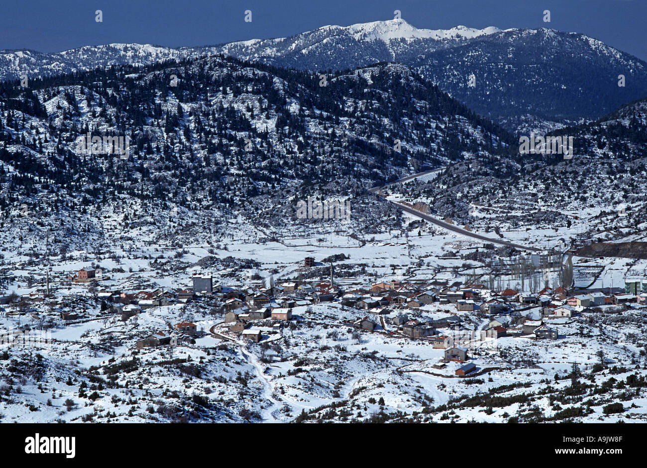 Rural scene of a village from the Taurus mountains en route from C Anatolia to the Coast Turkey A snow clad landscape March - Stock Image