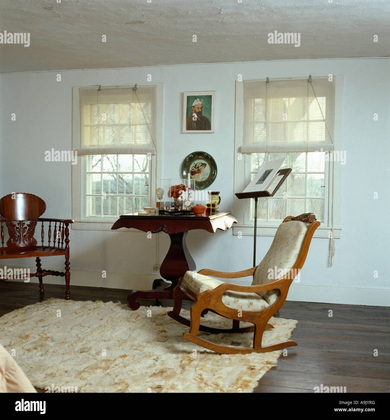 Cream Ponyskin Rug On Dark Wood Floor In White Bedroom With Rocking