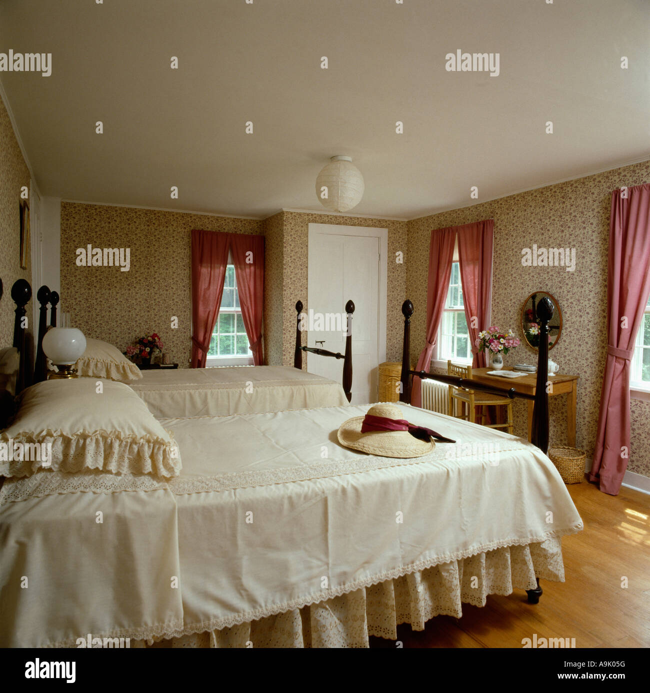 Cream Bedlinen On Twin Beds In Country Bedroom With Pink Curtains Stock Photo Alamy