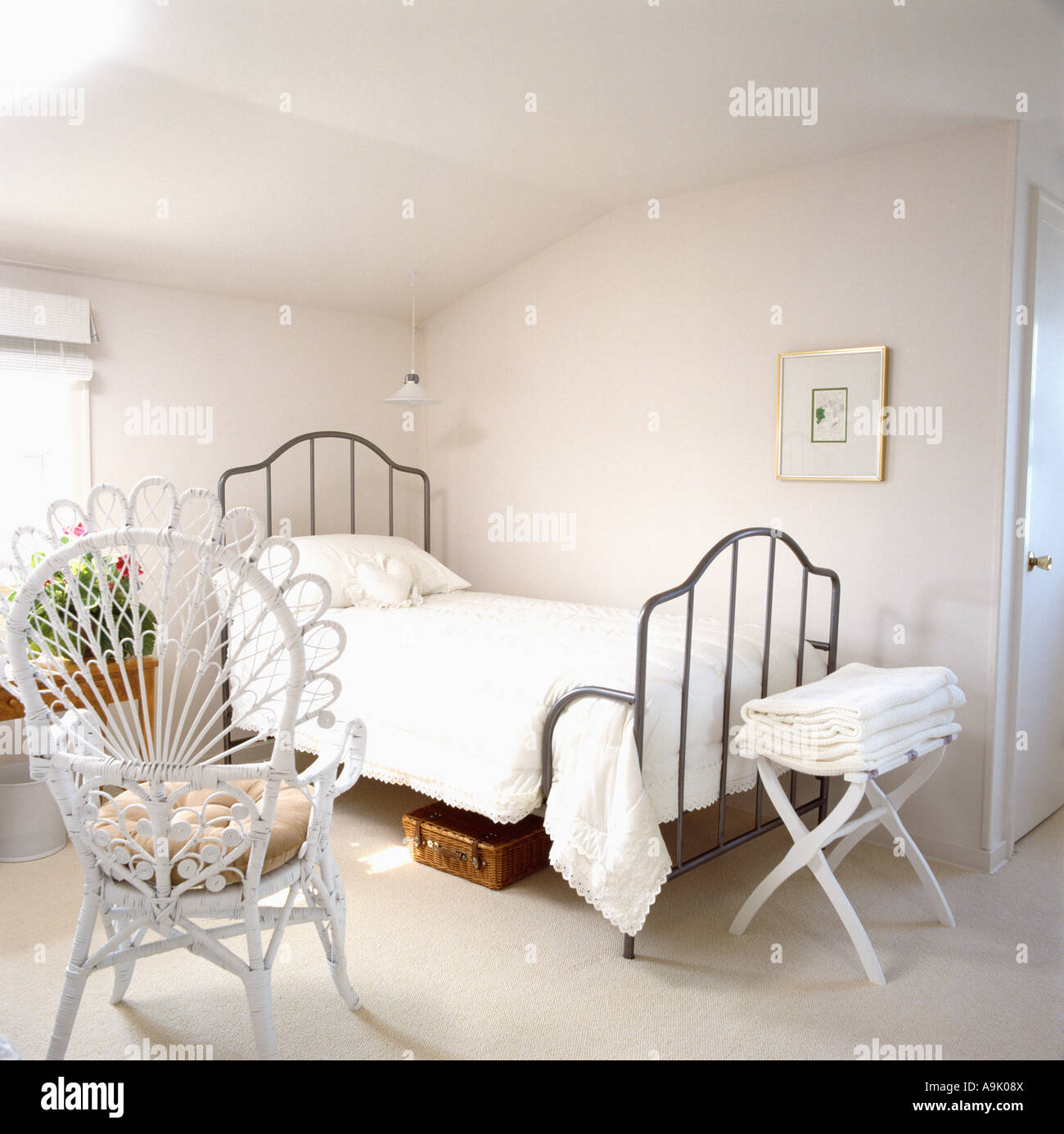 White Peacock Chair In Simple White Bedroom With Black Single Bedstead And  White Linen