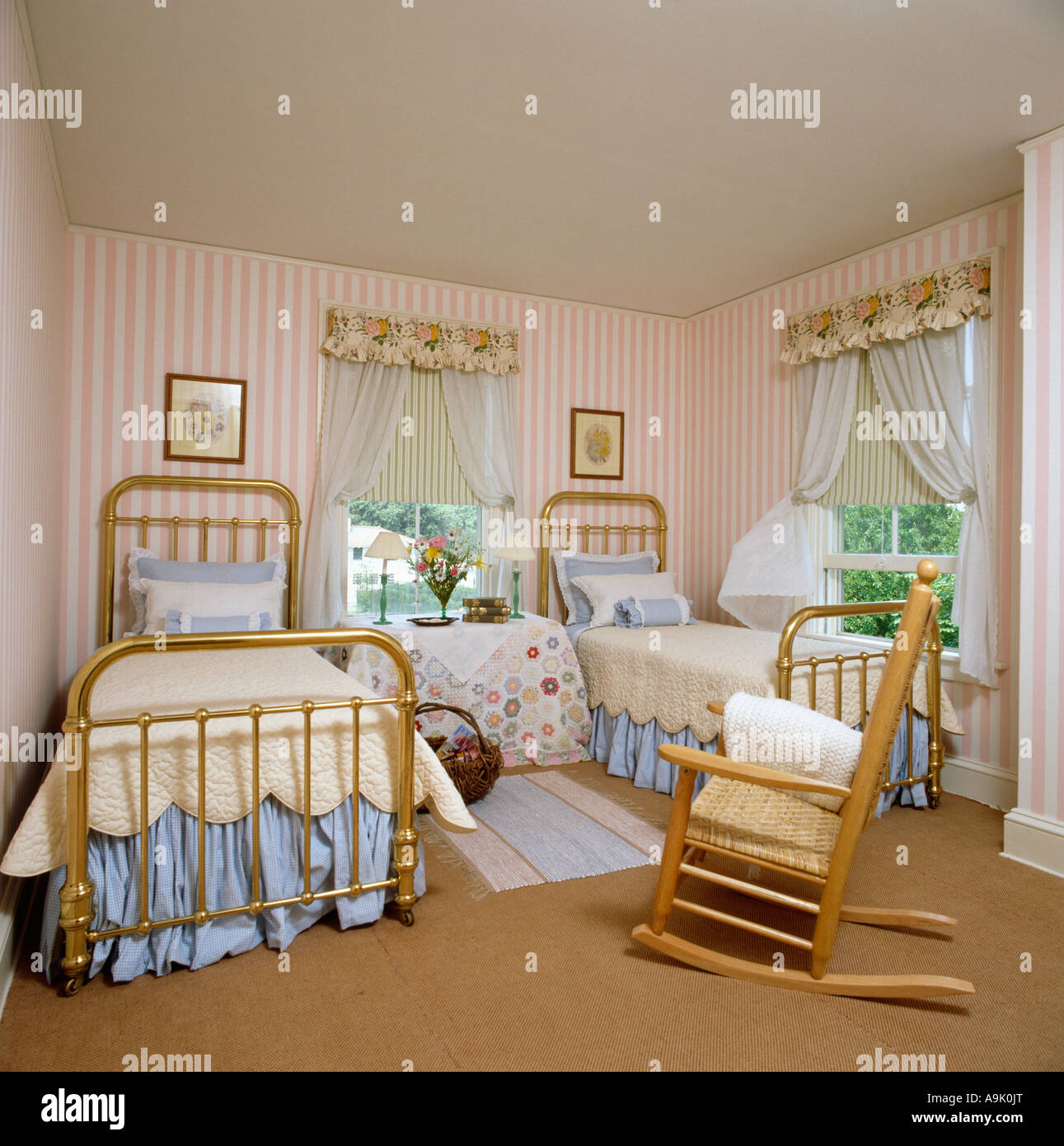 Rockingchair And Twin Beds With Brass Bedsteads In Bedroom With Pink