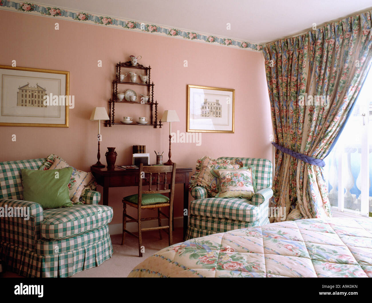 Green and white check armchairs in pink bedroom with pink ...